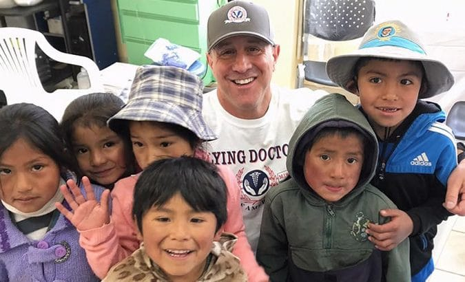 Dr. Doug with a group of children