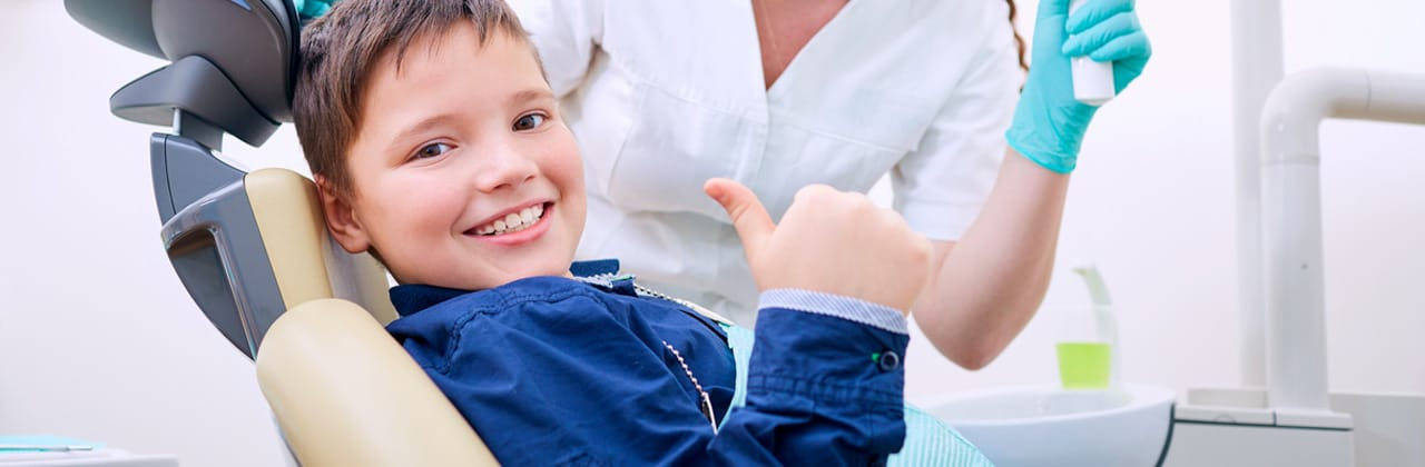 boy sitting on the dentist chair